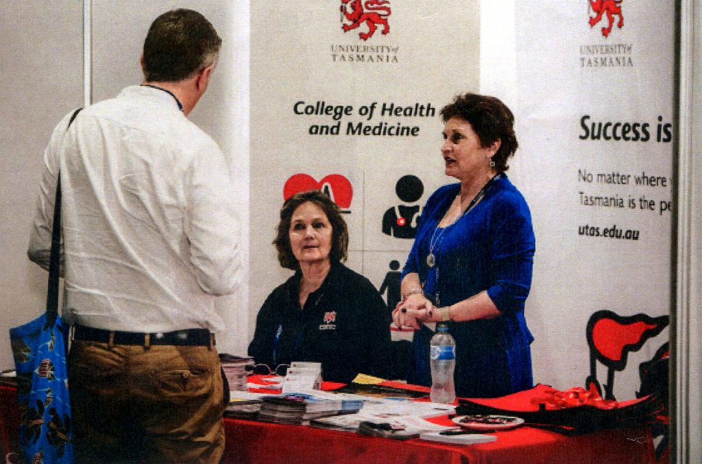 Wendy Quinn and Stella Webster at the UTAS Leadership Course Information Stand at the ACHSM Congress Darwin October 2018